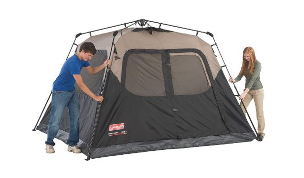 Two people putting up the Coleman 6-person Instant Tent