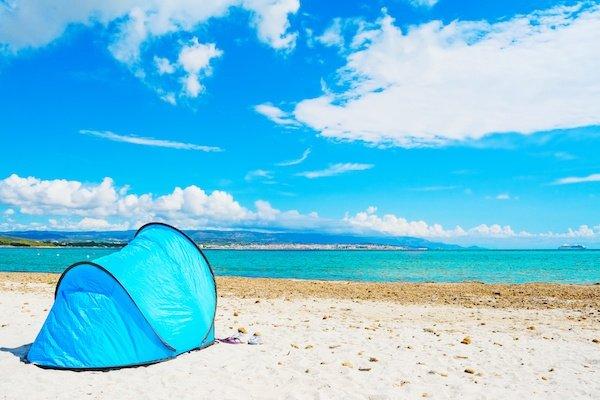 blue tent by the sea in Alghero Sardinia