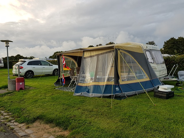 one of the best instant tents set up next to an RV