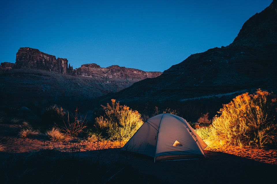 Photo of a tent near mountains