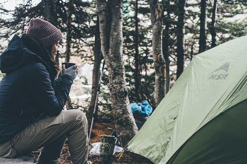 having coffee near the tent