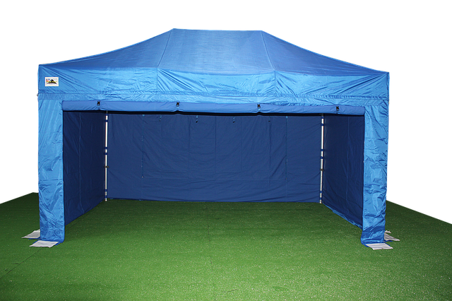a set up blue canopy tent