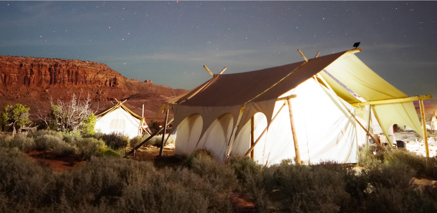 Best Tent Air Conditioner featured image of glamping tents in the desert
