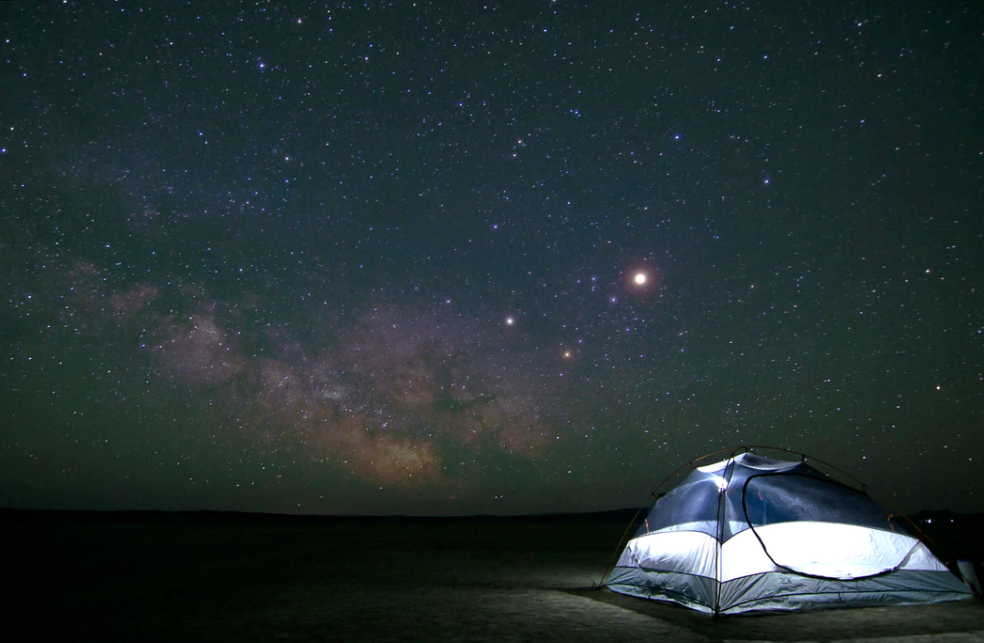 4 person tent under a huge starry sky showing the milky way